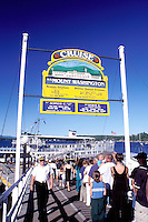New Hampshire, Weirs Beach, NH, Passengers standing in line waiting to board the M.S. Mt. Washington Cruise Boat on Lake Winnipesaukee.