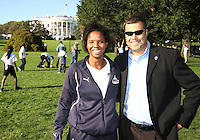 "Briana Scurry and Mark Washo of the Washington Freedom during a  D.C United clinic in support of first lady Michelle Obama's ""Let's Move"" initiative on the White House lawn, in Washington D.C. on October 7 2010."