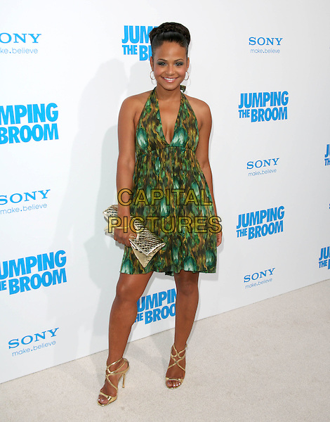 CHRISTINA MILIAN .at The Screen Gems L.A. Premiere of Jumping the Broom held at The Cinerama Dome Theatre in Hollywood, California, USA, May 4th 2011..full length dress hair up green print halterneck cleavage  make-up earrings  plait braid bun gold strappy sandals clutch bag .CAP/RKE/DVS.©DVS/RockinExposures/Capital Pictures.