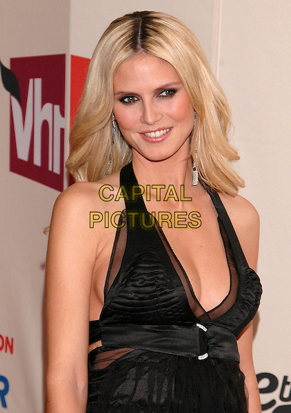 HEIDI KLUM.Arrivals at the VH1 Save The Music concert at the Beacon Theater in New York City. The event will benefit the Save The Music Foundation, a non-profit organization dedicated to restoring music programs in American public schools, New York, USA,.11 April 2005.portrait headshot black dress halterneck.Ref: ADM.www.capitalpictures.com.sales@capitalpictures.com.©Patti Ouderkirk /AdMedia/Capital Pictures