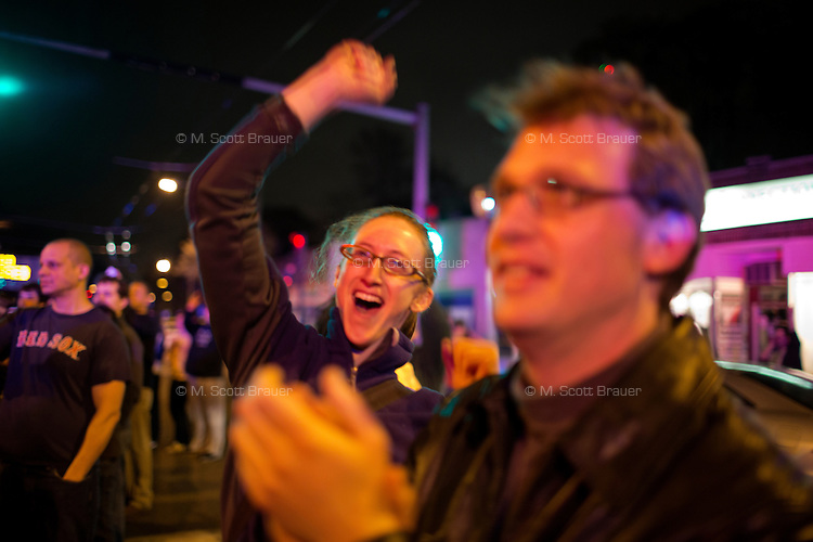 Crowds gather to celebrate in Watertown, Mass., on Mt. Auburn near the scene of the capture of Boston Marathon Bombing suspect #2 Dzhokhar Tsarnaev on April 19, 2013.  Tsarnaev was captured in a residential area of Watertown after a day-long search that shut down the metropolitan Boston area.