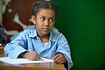 Refugee girl in class in a school operated by St. Andrew's Refugee Services in Cairo, Egypt. The school is supported by Church World Service.