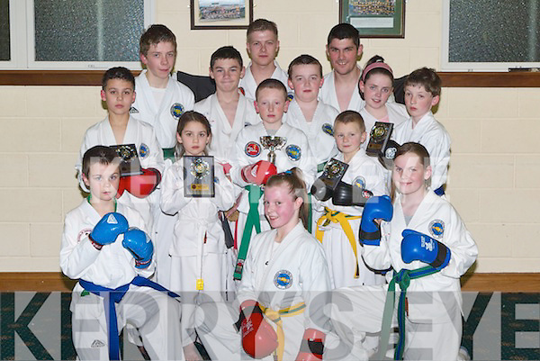MARTIAL ARTS: Some of the winners of the Munster Tae Kwon Do Competition, which was held in Mercy Mounthawk School Gym on Sunday, pictured during their training session on Tuesday night with their awards. Front l-r: Naomai O'Brien, Laurie O'Connor and Jimmy O'Riordan. Back: Kieran and Anna Murnal, PJ McGuire, Mikey Cahill, James Clifford, Cian O'Hanlon, Stephen Roche, Eoin O'Hanlon, Rachel O'Hara, Paudi Morrison and Shane Roche   Copyright Kerry's Eye 2008