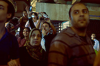 EGYPT / Cairo / 27.11.2012 / People look at protesters during a march from the Shubra neighbourhood to Tahrir square, where thousands of people have gathered to protest President Morsi's above-the-law constitutional declaration © Giulia Marchi