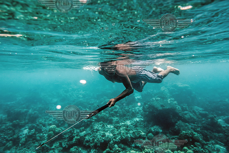 Dafrin Ambotang, 35, scans the rocky sea bed for fish near his village in the Togean islands, Indonesia. (Photo: Aurélie Marrier d'Unienville)