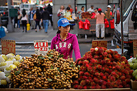 A woman works selling fruits at downtown Manhattan in New York. October 6, 2012. United States economy has gained 114,000 jobs, putting the jobless rate from 8.1 percent to 7.8 percent, first time it's been below 8 percent since 2009.  Photo by Eduardo Munoz Alvarez / VIEW.