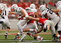 Ohio State Buckeyes defensive end Sam Hubbard (6) sacks Northern Illinois Huskies quarterback Drew Hare (12) during the fourth quarter of the NCAA football game at Ohio Stadium in Columbus on Sept. 19, 2015. (Adam Cairns / The Columbus Dispatch)