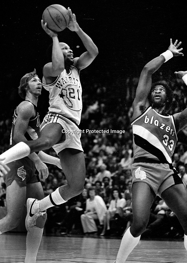 "Warriors Lloyd ""World"" Free over Portland Trailblazers Calvin Natt...(1982 photo/Ron Riesterer)"
