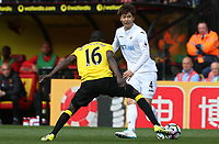 Ki Sung-yueng of Swansea City is challenged by Abdoulaye Doucoure of Watford during the Premier League match between Watford and Swansea City at Vicarage Road Stadium, Watford, England, UK. Saturday 15 April 2017