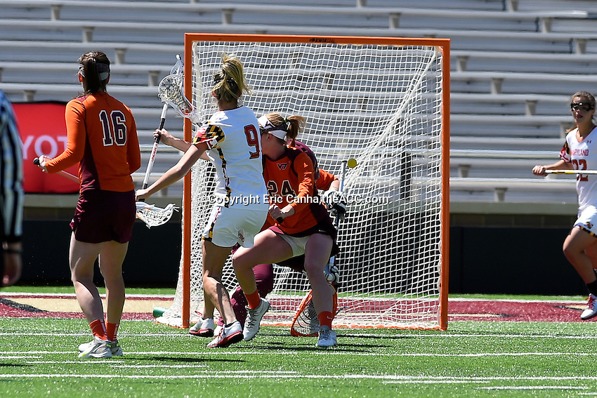 Maryland's Kristen Lamon (9) scores a goal  during the 2014 ACC Women's Lacrosse Quarterfinals in Boston, MA, Thursday, April 24, 2014. (Photo by Eric Canha,<br /> theACC.com)