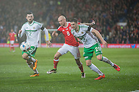David Cotterill of Wales gets between Conor McLaughlin and Craig Cathcart of Northern Ireland during the International Friendly match between Wales and Northern Ireland at Cardiff City Stadium, Cardiff, Wales on 24 March 2016. Photo by Mark  Hawkins / PRiME Media Images.