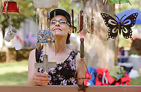 NWA Democrat-Gazette/DAVID GOTTSCHALK  Sandra McKinzie, of Pryor Okla., looks over a variety of chimes Monday, September 7, 2015 by Hannibal's Creations, of Texarkana, at the 64th annual Clothesline Fair at Prairie Grove Battlefield State Park. This is the first year Hannibal's Creations has participated in the fair.