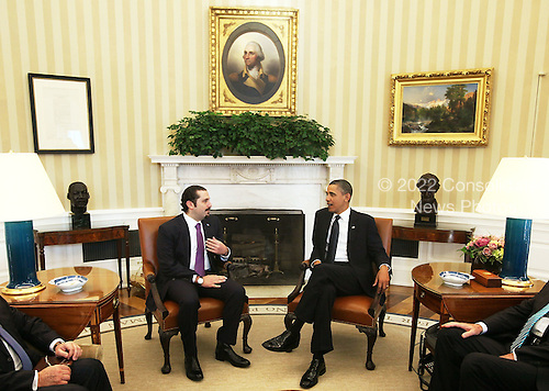 "United States President Barack Obama (R) meets with Prime Minister Saad Hariri (L) of Lebanon in the Oval Office of the White House Wednesday, January 12, 2011 in Washington, DC.  According to a White House media release, the two leaders met ""to discuss U.S. support for Lebanonís sovereignty, independence, and stability, the ongoing work of the Special Tribunal for Lebanon, and other regional issues."" .Credit: Alex Wong / Pool via CNP"