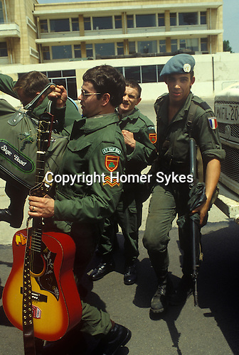 Irish UN, United Nations troops 47th Infantry Battalion arrive with guitars and skate boards to start a tour of duty. Beirut airport Lebanon 1980s.    They were part of United Nations Interim Force in Lebanon, UNIFIL.
