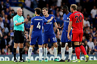 Cesc Fabregas of Chelsea has another word with referee, Lee Mason, concerning the time wasting from Huddersfield Town during Chelsea vs Huddersfield Town, Premier League Football at Stamford Bridge on 9th May 2018