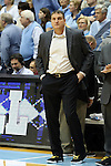 30 January 2016: Boston College head coach Jim Christian wore sneakers with gold laces as part of the Coaches vs. Cancer game. The University of North Carolina Tar Heels hosted the Boston College Eagles at the Dean E. Smith Center in Chapel Hill, North Carolina in a 2015-16 NCAA Division I Men's Basketball game. UNC won the game 89-62.