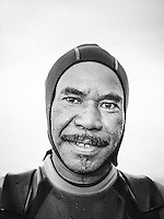 A portrait of a senior Papuan diver at the pier of Arborek, a small island in Raja Ampat archipelago, Indonesia.