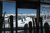 USA, California, Mammoth, a view of several skiers and snowboarders as the depart down the run at Mammoth Ski Resort