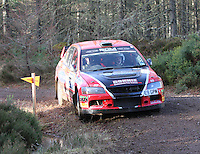 Donnie MacDonald - Andrew Falconer in a Mitsubishi Evolution competing at Junction 6 on the Munro Scotch Beef Millbuie Special Stage 1 on the 2014 Arnold Clark/Thistle Hotel Snowman Rally, supported by Highland Office Equipment, part of Capital Document Solutions which was organised by Highland Car Club and based in Inverness on 22.2.14; Round 1 of the 2014 RAC MSA Scottish Rally Championship sponsored by ARR Craib Transport Limited.