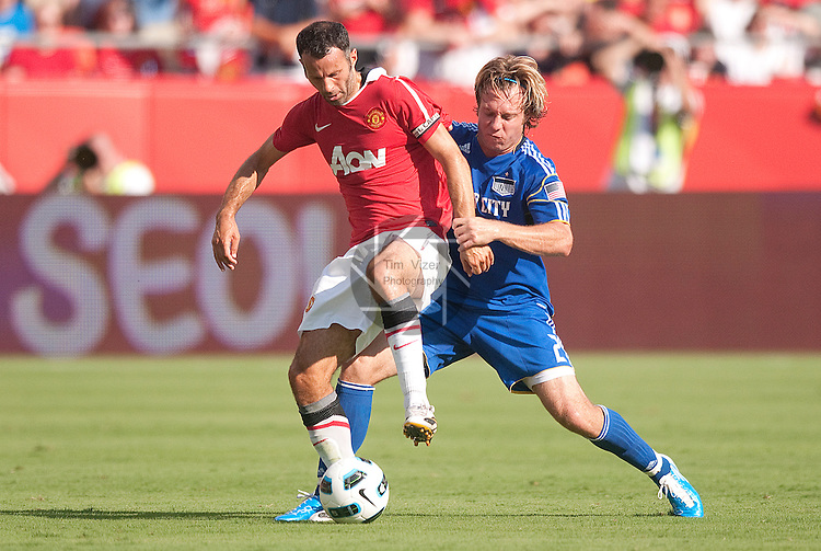 "July 25, 2010          Kansas City Wizards defender/midfielder Michael Harrington (2) tries to reach from behind Manchester United midfielder Ryan Giggs (11, left) in the first half.  The Kansas City Wizards of Major League Soccer defeated Manchester United of the English Premier League 2-1 in an international friendly game on Sunday July 25, 2010 at Arrowhead Stadium in Kansas City, Missouri.  The game is the third of four stops for Manchester United on their ""Tour 2010""."