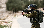 Israeli troops take position during clashes with Palestinian protesters following a demonstration against the expropriation of Palestinian land by Israel in the village of Kfar Qaddum, near Nablus, in the occupied West Bank on June 22, 2018. Photo by Shadi Jarar'ah