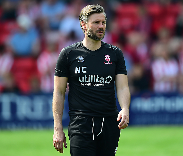 Lincoln City's assistant manager Nicky Cowley during the pre-match warm-up<br /> <br /> Photographer Andrew Vaughan/CameraSport<br /> <br /> The EFL Sky Bet League Two - Lincoln City v Tranmere Rovers - Monday 22nd April 2019 - Sincil Bank - Lincoln<br /> <br /> World Copyright © 2019 CameraSport. All rights reserved. 43 Linden Ave. Countesthorpe. Leicester. England. LE8 5PG - Tel: +44 (0) 116 277 4147 - admin@camerasport.com - www.camerasport.com