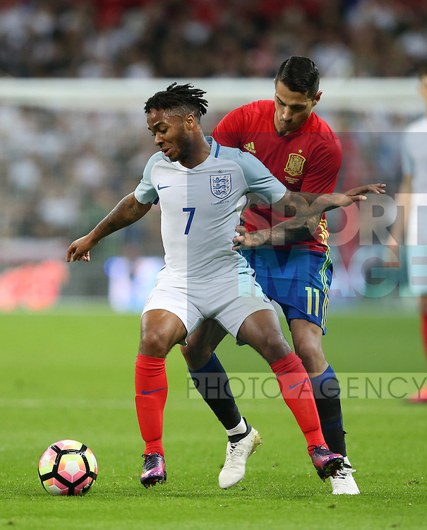 England's Raheem Sterling tussles with Spain's Vitolo during the friendly match at Wembley Stadium, London. Picture date November 15th, 2016 Pic David Klein/Sportimage