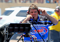 Jul. 20, 2014; Morrison, CO, USA; NHRA funny car driver Terry Haddock talks with wife NHRA top fuel driver Jenna Haddock over a 2-way radio during the Mile High Nationals at Bandimere Speedway. Mandatory Credit: Mark J. Rebilas-