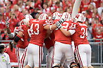 MADISON, WI - SEPTEMBER 9: The Wisconsin Badgers celebrate P.J. Hill #39 touchdown against the Western Illinois Leathernecks at Camp Randall Stadium on September 9, 2006 in Madison, Wisconsin. The Badgers beat the Leathernecks 34-10. (Photo by David Stluka)