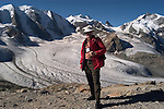 Switzlerland: Hiking the Swiss Glaciers near St. Moritz, taking the Diavolezza Morteratsch hike..Author Lee Foster prepares to hike. .Photo copyright Lee Foster, 510/549-2202, lee@fostertravel.com, www.fostertravel.com..Photo #: swisse11422
