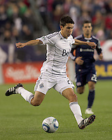Vancouver Whitecaps FC midfielder Shea Salinas (22) passes the ball. In a Major League Soccer (MLS) match, the New England Revolution defeated the Vancouver Whitecaps FC, 1-0, at Gillette Stadium on May14, 2011.