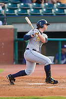 Jeff Malm (23) of the Montgomery Biscuits follows through on his swing against the Chattanooga Lookouts at AT&T Field on July 24, 2014 in Chattanooga, Tennessee.  The Biscuits defeated the Lookouts 6-4. (Brian Westerholt/Four Seam Images)