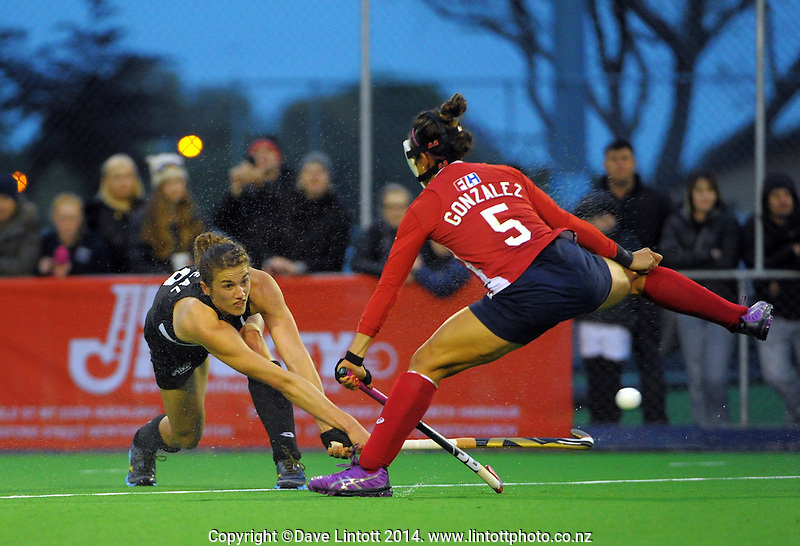 Brooke Neal shoots past Melissa Gonzalez during the international women's hockey match between the NZ Black Sticks and USA at Endeavour Twin Turfs, Palmerston North, New Zealand on Thursday, 23 October 2014. Photo: Dave Lintott / lintottphoto.co.nz