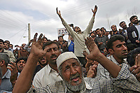 Villagers from the Iranian province of Golestan pray and invoke blessings on Iranian President Mahmoud Ahmadinejad, whilst they gather in crowds to watch one of his speeches.