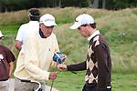 DEN DOLDER - Reinier Saxton (r) met zijn grootvader Marlof Strumphler als caddy, tijdens het NK Strokeplay golf op Golfsocieteit  De Lage Vuursche. COPYRIGHT KOEN SUYK