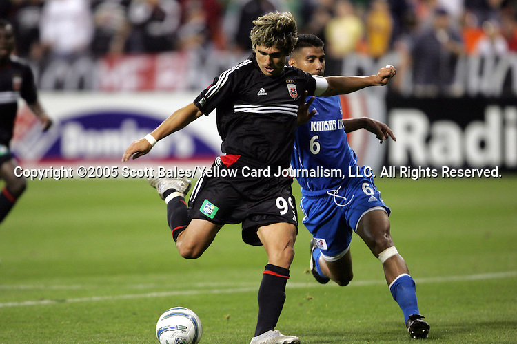 21 May 2005: Kansas City's Jose Burciaga Jr. (right) pushes DC United's Jaime Moreno as he prepares to shoot. DC United defeated the Kansas City Wizards 3-2 at RFK Stadium in Washington, DC in a regular season Major League Soccer game. .