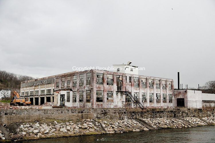 TORRINGTON, CT, 23 APRIL 15 -  Demolition of the Nidec building on Franklin Drive began in mid-April. The building nearest the river was the last to fall. It came down this week.   Alec Johnson/ Republican-American