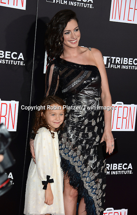 Anne Hathaway in Rodarte black dress and JoJo Kushner attend the New York Premiere of &quot;The Intern&quot; on September 21, 2015 at The Ziegfeld Theatre in New York, New York, USA.<br /> <br /> photo by Robin Platzer/Twin Images<br />  <br /> phone number 212-935-0770