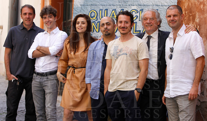 "Da sinistra: uno dei produttori del film Valerio Mastandrea, l'attore Michele Riondino, l'attrice Greta Scarano, il regista  Saverio di Biagio, l'attore Michele Alhaique, l'attore Giorgio Colangeli, uno dei produttori alberto Leotti posano durante il photocall per la presentazione del film ""Qualche Nuvola"" a Roma, 25 giugno 2012..From left: one of the producers Valerio Mastandrea, italian actor Michele Riondino, italian actress Greta Scarano, italian director  Saverio di Biagio, italian actor Michele Alhaique, italian actor Giorgio Colangeli, one of the producers Alberto Leotti pose during the photocall for the presentation of the movie ""Qualche Nuvola"" in Rome 25 June 2012.UPDATE IMAGES PRESS/Isabella Bonotto"
