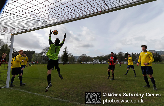 Keswick 1 Kendal 1, 15/04/2017. Fitz Park, Westmoreland League. The Kendal goalkeeper juggles a high ball. Photo by Paul Thompson.