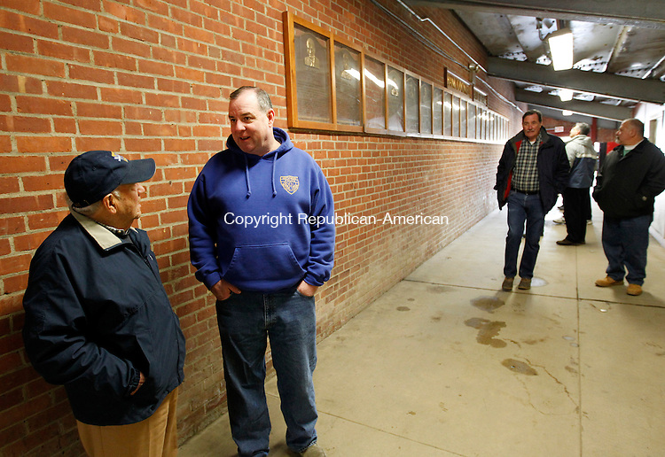 Waterbury, CT-28 January 2012-012812CM11- Francis Calabro, chairman of the board of public works,  chats with Waterbury Mayor Neil M. O'Leary at Municipal Stadium in Waterbury Saturday morning.  City officials and politicians were on a tour of the stadium, including the The Board of Aldermen, who will need two votes from the Republican's to spend 2.5 million of tax dollars to fix it up.      Christopher Massa Republican-American