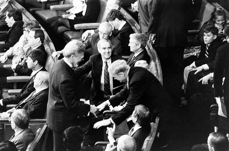 John Murtha, Chairman of the Defense Appropriations Subcommitte, bows to Rep. Ron Dellums, D-Calif.  Rep. Dellums is likely soon to be the Chairman of Armed Service Committee before swear-in ceremony. January 5, 1993. (Photo by Maureen Keating/CQ Roll Call)