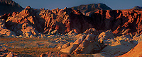 971000005 panoramic view -  low angled sunset light highlights the sandstone formations and red rock mountains giving a three dimensional effect to the scene in valley of fire state park nevada