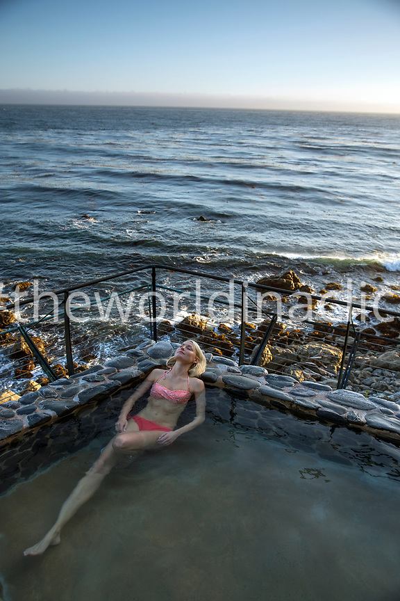 USA, California, Big Sur, Esalen, a woman sits in the Baths and relaxes at the Esalen Institute