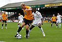 Danny Wright of Cambridge United shields the ball from Eddie Odhiambo of Newport during the Blue Square Bet Premier match between Cambridge United and Newport County at the Abbey Stadium, Cambridge  on 25th September, 2010.© Kevin Coleman