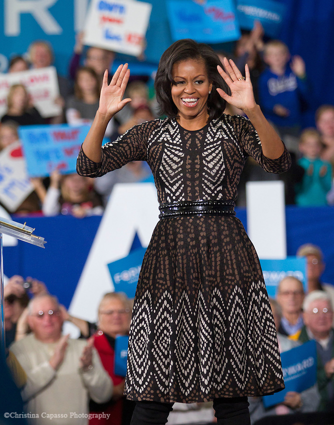 First Lady Michelle Obama speaks to a large crowd of supporters at the University of Wisconsin in Wausau. She encouraged the crowd of 980 people, plus 600 more in an overflow room, to vote early. (Christina Capasso/Polaris)