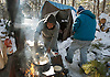 Mexican campers make their afternoon meal at their campsite at the Homeless Camp in Lakewood.