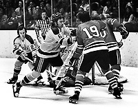 Seals vs BlackHawks,  Bob Stewart and Ted McAneeley protecting his goalie, #19 is Dale Tallon.(1973 photo by Ron Riesterer)