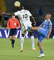 BOGOTÁ -COLOMBIA, 03-05-2014. Wesley Lopes (Der.) jugador de Millonarios disputa el balón con Helibelton Palacios (Izq.) jugador de La Equidad  durante partido de vuelta por los cuartos de final de la Liga Postobón  I 2014 jugado en el estadio Nemesio Camacho el Campín de la ciudad de Bogotá./ Wesley Lopes (R) player of Millonarios fights for the ball with Helibelton Palacios (L) player of La Equidad during second leg match for the quarterfinals of the Postobon League I 2014 played at Nemesio Camacho El Campin stadium in Bogotá city. Photo: VizzorImage/ Gabriel Aponte / Staff