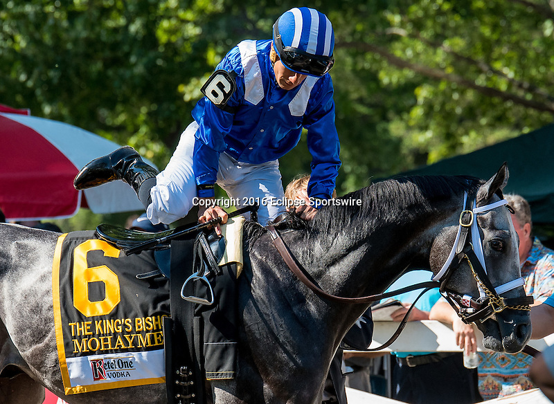 SARATOGA SPRINGS - AUGUST 27: Jockey Junior Alvarado gets aboard Mohaymen #6 in the paddock before Ketel One King's Bishop Stakes on Travers Stakes Day at Saratoga Race Course on August 27, 2016 in Saratoga Springs, New York. (Photo by Dan Heary/Eclipse Sportswire/Getty Images)
